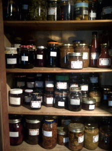 Image of pickles and jams in cupboard