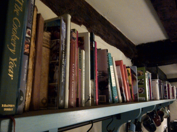 Image of a crowded book shelf