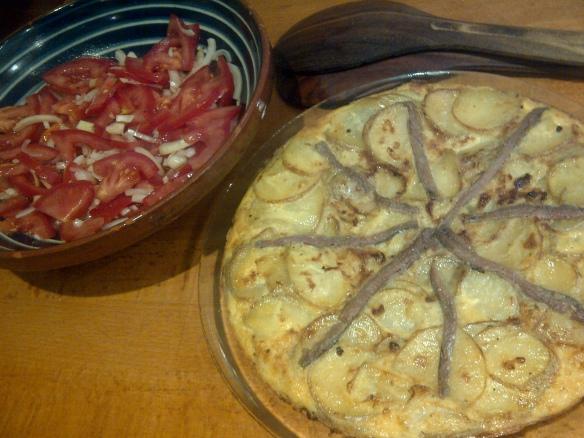 Image of a potato tortilla and a tomato salad