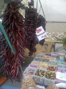 Image of dried peppers hanging in a market