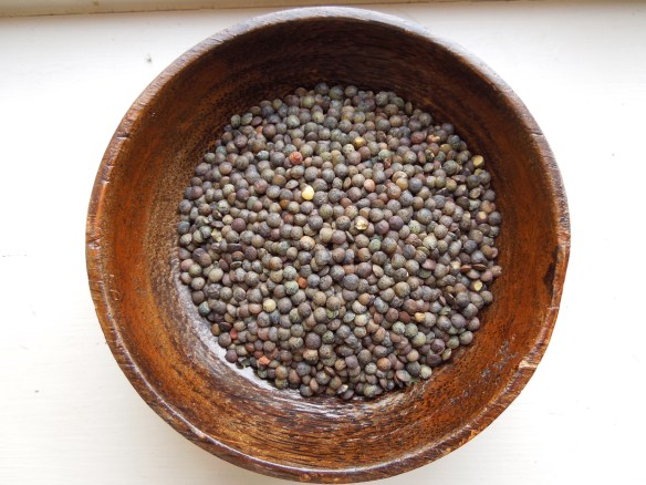 Image of Puy lentils in a wooden bowl