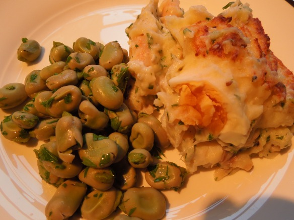 Image of a portion of fish pie served with broad beans