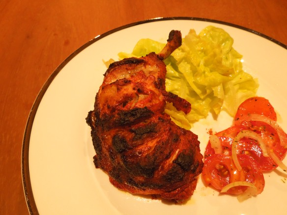 Image of tandoori chicken on a plate with salad
