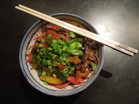 Image of stir fry in bowl with chopsticks