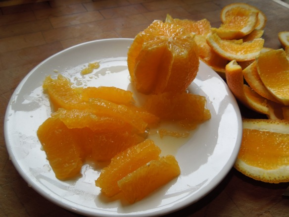 Image of an orange being cut into segments