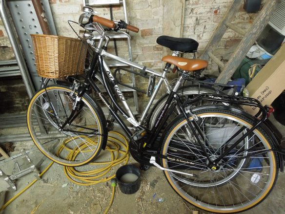 Image of two bicycles in a shed