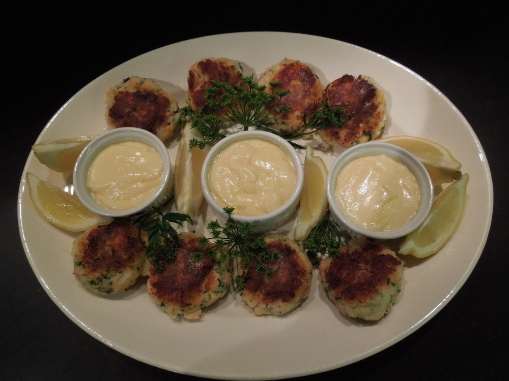Image of fishcakes served with pots of hollandaise sauce
