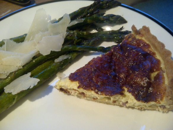 Image of slice of flan with asparagus on the side