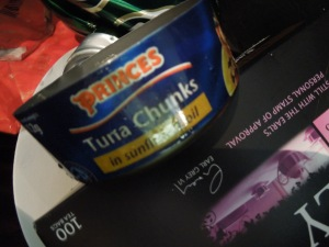 Image of an empty tuna tin in bin