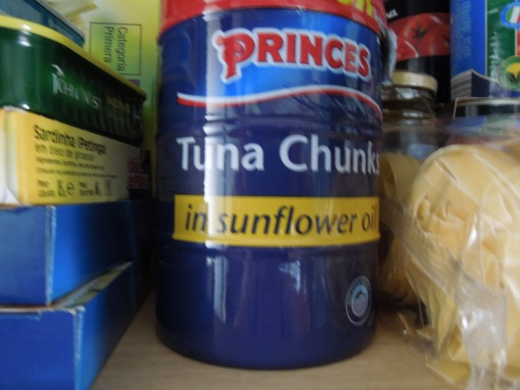Image of tins of tuna in a store cupboard