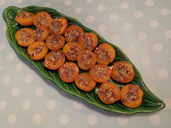 Stuffed roasted apricots on a dish
