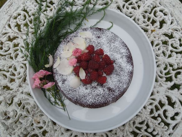 Image of chocolate almond cake with berries