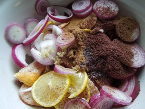 Image of chicken with the marinade ingredients