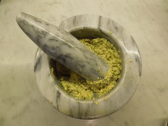 Image of the pounded nuts in a pestle and mortar