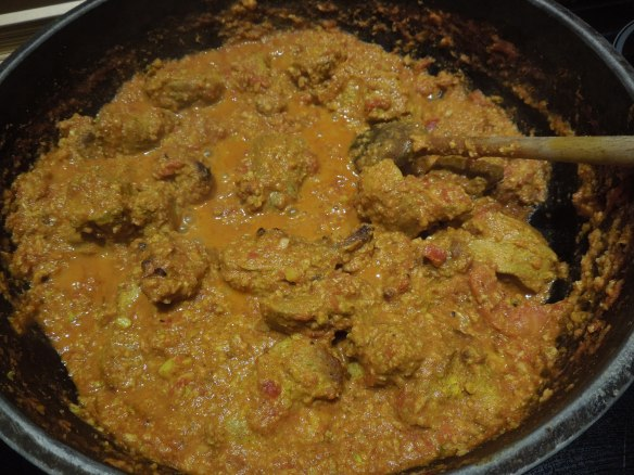 Image of butter chicken cooking in a pan