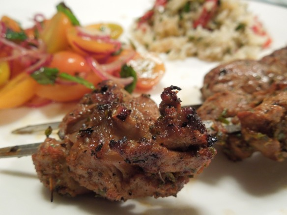 Image of kebabs and salads