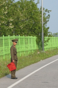 Image of North Korean soldier at border post