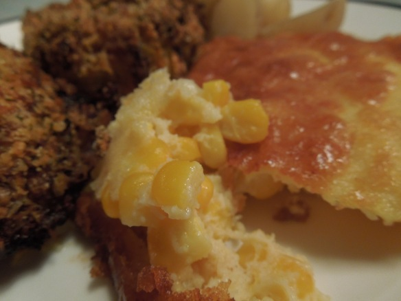 Image of corn pudding on a plate with fried chicken
