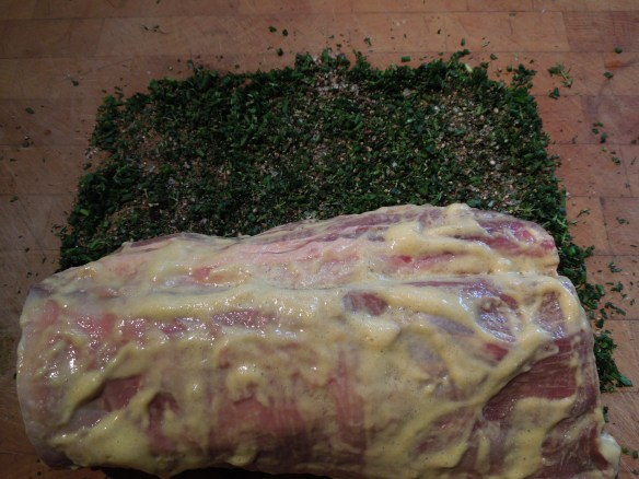 Image of coated fillet about to be rolled in herb crust