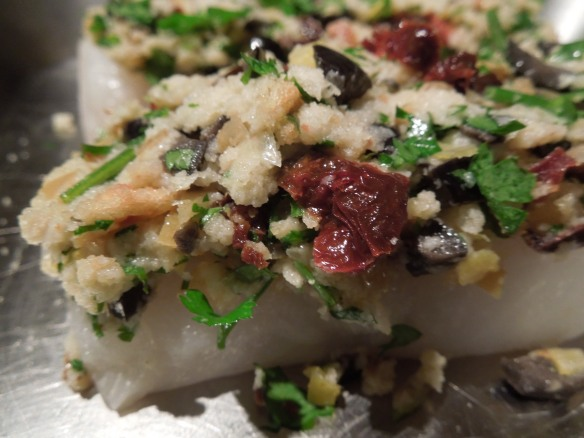 Image of cod with topping before going in oven