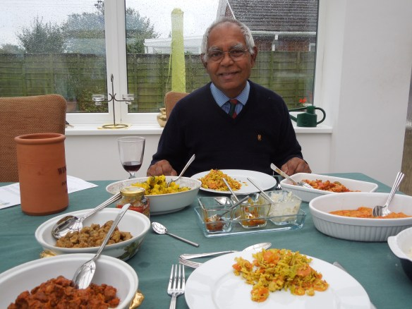 Image of Don at a table spread with food