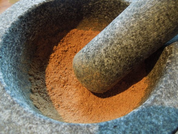 Image of spices ground in a mortar