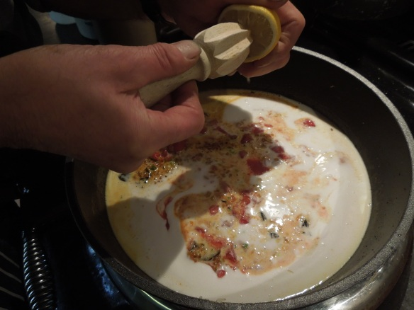 Image of lemon juice being added to sauce