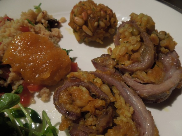Image of lamb served with couscous and salad