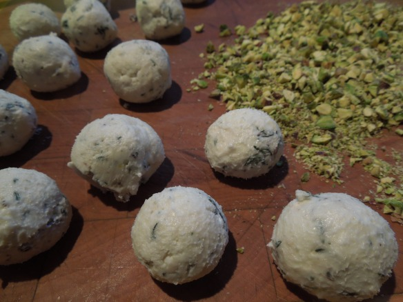 Image of cheese balls ready to roll in pistachio crumbs