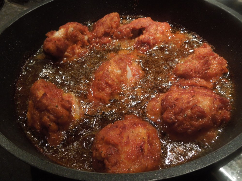 Image of chicken pieces frying