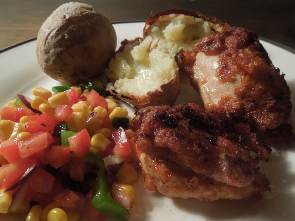 Image of crispy coated chicken served with sweetcorn salad and baked spuds