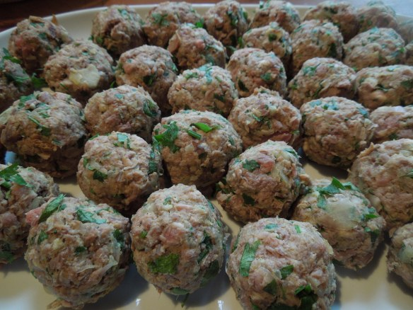 Image of meatballs rolled and ready for cooking