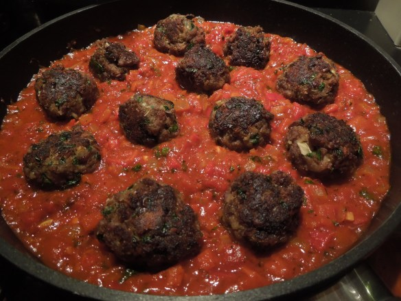 Image of meatballs cooking in sauce