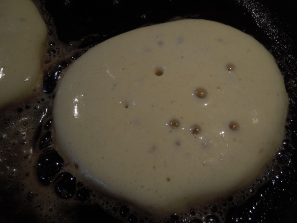 Image of pancake cooking, with bubbles rising