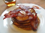 Image of a stack of pancakes topped with bacon