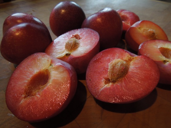 Image of plums, halved