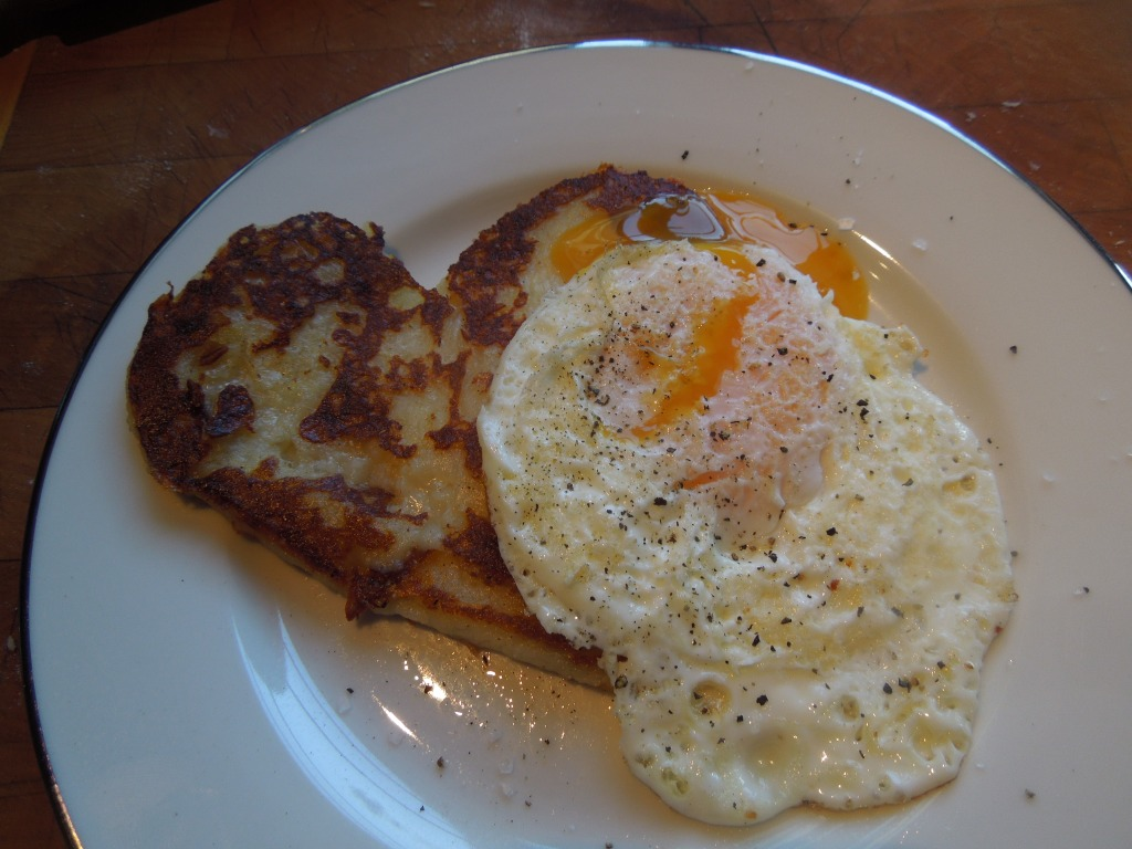Image of cooked farl with a fried egg on top