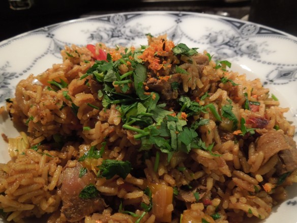 Image of pilaf topped with parsley and orange zest
