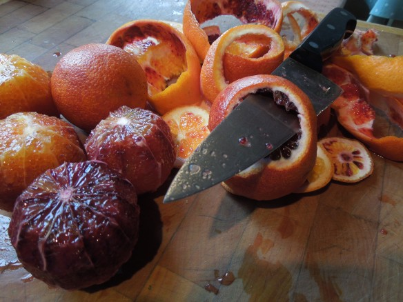 Image of blood oranges being peeled