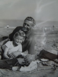 Image of a young Mrs P and her dad at the seaside