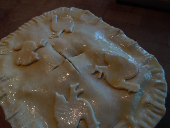 Image of uncooked pie, glazed and ready for the oven