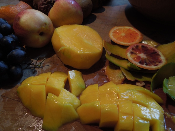 Image of fruit being peeled and sliced