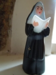 Image of a small plastic nun