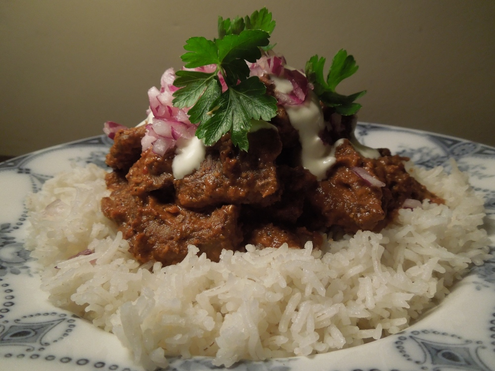 Image of venison mole served with rice