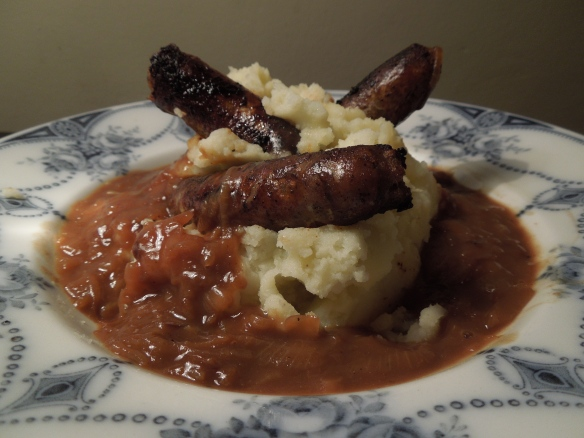 Image of sausages, mash and onion gravy