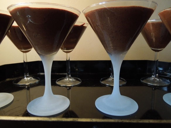 Image of mousse spooned into glasses