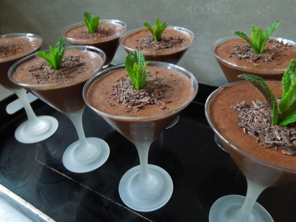Image of mousse in glasses garnished with chocolate shavings and mint
