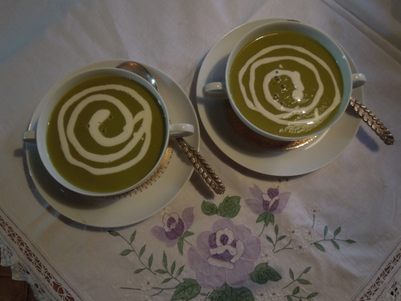 Image of asparagus soup swirled with cream