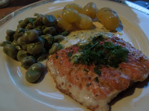 Image of salmon srved with broad beans and new potatoes