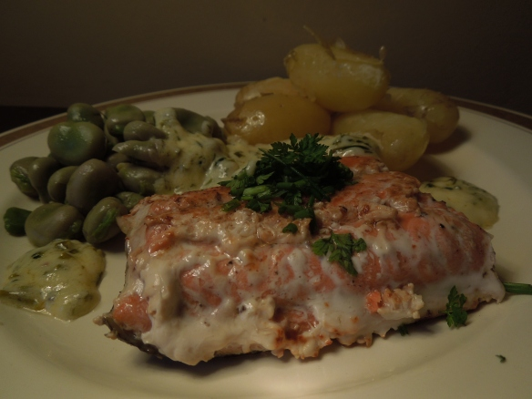 Image of salmon served with broad beans and new potatoes